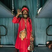 A sadhu holy man selling religious items, silver bracelet etc.  Throughout the journey, peddlers pop into the train compartments with all sorts of offerings,  to be bargained for a few rupees.<br /> Inside the Dibrugarh-Kanyakumari Vivek Express, the longest train route in the Indian Subcontinent. It joins Kanyakumari, Tamil Nadu, which is the southernmost tip of mainland India to Dibrugarh in Assam province, near the border with Burma.