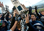 """Duchesne players celebrate their """"three-peat"""" victory in the Utah High School 1A Football championship game between Duchesne and Rich in Pleasant Grove, Saturday, Nov. 10, 2012."""