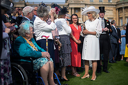 The Duchess of Cornwall during a garden party at Buckingham Palace in London.
