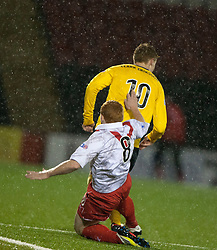 Airdrie United's Nathan Blockley tackles Falkirk's Jay Fulton and gets a second yellow, red card..Airdrie United 1 v 4 Falkirk, 22/12/2012..©Michael Schofield.