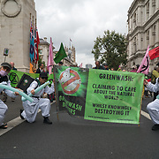 2021-09-01, London, UK. Extinction Rebellion protest Greenwash Action marching in Centre London demand the UK government stop funding fossil fuel.