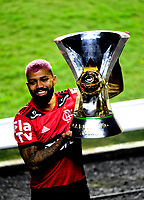 SAO PAULO, BRAZIL - FEBRUARY 25: Gabriel Barbosa of CR Flamengo poses with champions trophy ,after a Brasileirao Serie A 2020 match between Sao Paulo FC and CR Flamengo at Morumbi Stadium on February 25, 2021 in Sao Paulo, Brazil. (Photo by MB Media/BPA)