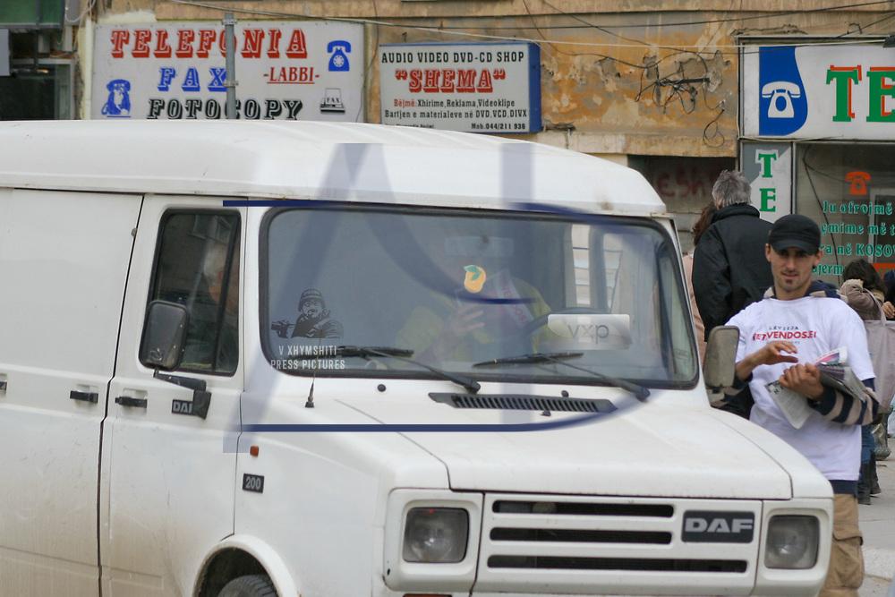 "Kosovo's self-determination movement activist Luan Aliu is seen handing over the weekly newspaper ""Vetevendosje"" to the people in Gjilan, southeastern Kosovo on March 1, 2008. (Photo by Vudi Xhymshiti)"