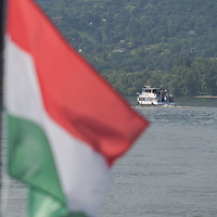 Passengers boat is seen in the bend of River Danube from another boat after the ease of the COVID-19 restrictions near Nagymaros, Hungary on June 29, 2020. ATTILA VOLGYI