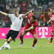 Turkey's Hamit ALTINTOP (C) and Germany's Bastian SCHWEINSTEIGER (L) during their UEFA EURO 2012 Qualifying round Group A matchday 19 soccer match Turkey betwen Germany at TT Arena in Istanbul October 7, 2011. Photo by TURKPIX