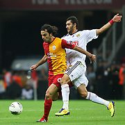Galatasaray's Selcuk INAN (L) and Eskisehirspor's Veysel SARI (R) during their Turkish Super League soccer match Galatasaray between Eskisehirspor at the TT Arena at Seyrantepe in Istanbul Turkey on Monday, 26 September 2011. Photo by TURKPIX