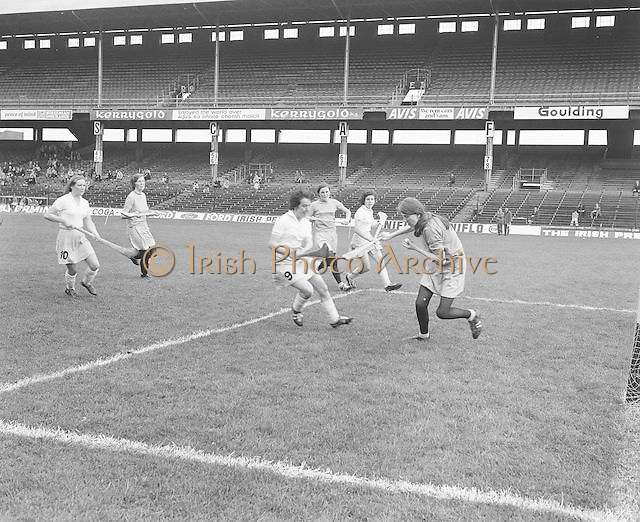 Clare makes a shot at goal as the Dublin goalie attempts to block it during the Dublin v Clare All Ireland Junior Camogie Final in Croke Park on the 15th of September 1974.