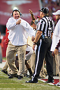 Arkansas Razorback head coach Bret Bielema reacts to a call during an NCAA college football game against Texas A&M in Fayetteville, Ark., Saturday, Sept. 28, 2013. Texas A&M defeated Arkansas 45-33. (AP Photo/Beth Hall)