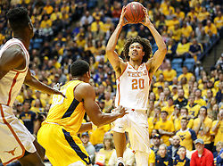 Jan 20, 2018; Morgantown, WV, USA; Texas Longhorns forward Jericho Sims (20) drives to the basket during the first half against the West Virginia Mountaineers at WVU Coliseum. Mandatory Credit: Ben Queen-USA TODAY Sports