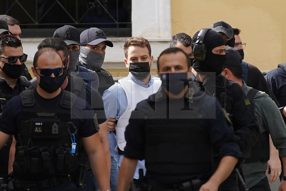 © Licensed to London News Pictures. 22/06/2021. Athens, Greece. Babis Anagnostopoulos arrives at a court escorted by police in Athens. The 33-year-old helicopter pilot and flight instructor Babis Anagnostopoulos has been detained as a suspect in the murder of his British wife Caroline Crouch, 20, outside Athens last month after publicly claiming she'd been killed during a brutal invasion of the couple's home, police said. Photo credit: Ioannis Alexopoulos/LNP