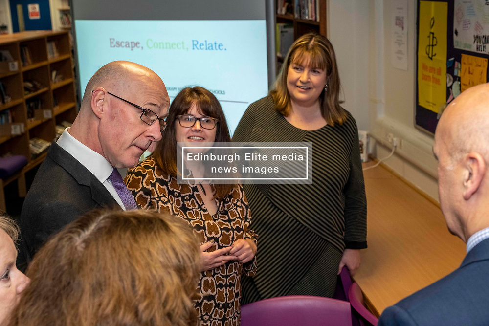 Pictured: July Jamison (glasses) from Education Scotland outlined the on-line access to the project to Mr Swinney<br /> <br /> The Deputy First Minister and Education Secretary visited the Royal High School in Edinburgh today and met students and staff to learn about a school library project aimed at tackling mental health issues.<br /> <br /> Ger Harley   EEm 10 October 2019
