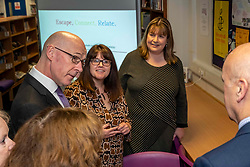 Pictured: July Jamison (glasses) from Education Scotland outlined the on-line access to the project to Mr Swinney<br /> <br /> The Deputy First Minister and Education Secretary visited the Royal High School in Edinburgh today and met students and staff to learn about a school library project aimed at tackling mental health issues.<br /> <br /> Ger Harley | EEm 10 October 2019