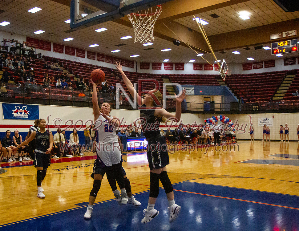 Moore's Kelsi Fitzgerald with a lay up against Southmoore's Erin Bean during their game on Tuesday, December 18, 2018 at Moore High School.