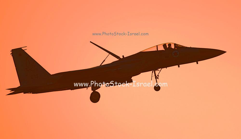 Israeli Air force (IAF) F-15 (Baz) Fighter jet in flight at sunset