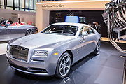 """New York, NY - 1 April 2015. A Rolls Royce Wraith in the """"Inspired by Film"""" package, which harkens back to the golden age of film. A prop movie light can be seen at the right of the frame, and the vehicle sports doors hinged at the rear, called by Rolls """"coach doors,"""" but popularly referred to as """"suicide doors."""""""
