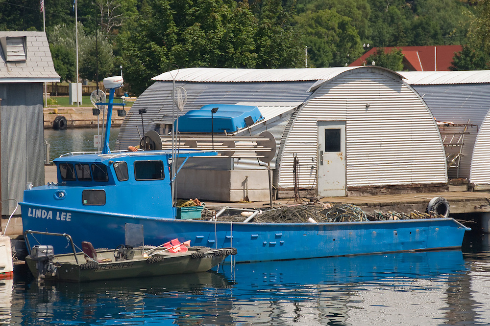A commercial fishing boat for Thills Fish House on the lower harbor of Marquette Michigan.
