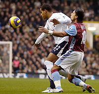 Photo: Ed Godden.<br /> Tottenham Hotspur v Aston Villa. The Barclays Premiership. 26/12/2006. Spurs' Tom Huddlestone (L), holds off Milan Baros.