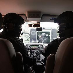 Entraînement des policiers du RAID à l'intervention dans un milieu potentiellement contaminé par des substances NRBC.<br /> Décembre 2016 / Saclay (91) / FRANCE<br /> Voir le reportage complet (105 photos) http://sandrachenugodefroy.photoshelter.com/gallery/2016-12-Exercice-du-RAID-au-CEA-Complet/G0000WzLa11UDCFk/C0000yuz5WpdBLSQ
