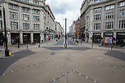 UNITED KINGDOM, London: 01 April 2020 Oxford Circus this afternoon. The image shows the extent of both how desolate the city has become since the nation was told to stay indoors to prevent the spread of the coronavirus, but also brings attention to how symmetrical London can be. <br /> Rick Findler / Story Picture Agency