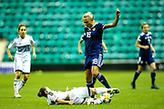 Antria Michail (#8) of Cyprus slides in to the win the ball from Claire Emslie (#18) of Scotland during the Women's Euro Qualifiers match between Scotland Women and Cyprus Women at Easter Road, Edinburgh, Scotland on 30 August 2019.