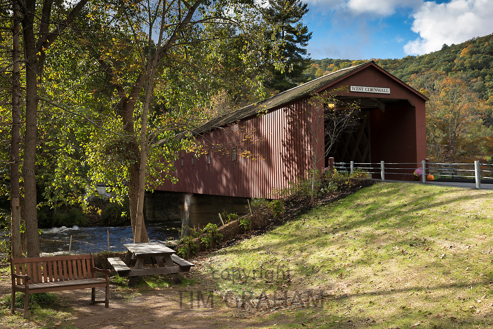 Constructed as a wooden structure West Cornwall covered bridge and Housatonic River during The Fall in Connecticut, USA