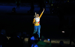 Sally Pearson runs in with the Commonwealth Torch during the Opening Ceremony for the 2018 Commonwealth Games at the Carrara Stadium in the Gold Coast, Australia.