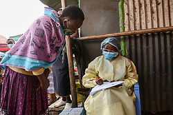 May 1, 2020, Nairobi, Kenya: A health worker in protective gear as a precaution collects details of a resident during the corona virus pandemic..A mass testing of COVID-19 cases in the area of Kawangware was carried out on residents. Kenya has so far reported 411 cases of the coronavirus, 144 recoveries and 17 deaths. (Credit Image: © Dennis Sigwe/SOPA Images via ZUMA Wire)