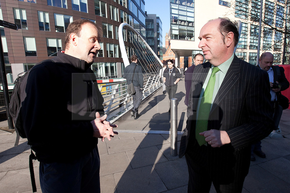 © licensed to London News Pictures. Manchester, UK  27/03/2012. A man remonstrates with Norman Baker about the lack of investment in cycling facilities at newly refurbished railway stations. The man said he had written to the MP's department and not received a reply. Norman Baker, MP for Lewes and Parliamentary Under Secretary for the Department for Transport, at the launch of the Brompton cycle hire scheme at Manchester Piccadilly Railway Station. Photo credit should read Joel Goodman/LNP