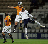 Photo: Paul Thomas/Sportsbeat Images.<br /> Preston North End v Hull City. Coca Cola Championship. 04/12/2007.<br /> <br /> Patrick Agyemang (9) of Preston jumps for the ball with Wayne Brown.