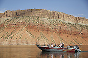 SHOT 6/8/16 9:23:45 AM - Flaming Gorge Reservoir straddles the Utah-Wyoming border and was completed in 1964. The reservoir is mainly in southwest Wyoming and partially in northeastern Utah. The northern tip of the reservoir is 10 miles southeast of Green River, Wyoming, 14 miles southwest of Rock Springs, Wyoming, and 43 miles north of Vernal, Utah. Visitors enjoy world class fishing, hiking, boating, windsurfing, camping, backpacking, cross-country skiing, and snowmobiling within Flaming Gorge National Recreation Area, which is operated by Ashley National Forest. (Photo by Marc Piscotty / © 2016)