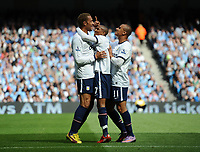 Football - Premier League - Manchester City vs. Aston Villa<br /> Aston Villa's John Carew celebrates with Ashley Young and Gabriel Agbonlahor after scoring the opening goal at the City of Manchester Stadium