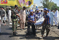 June 23, 2017 - Quetta, Pakistan - Emergency crew retrieve bodies after suicidal blast at IGP Office Roundabout in Quetta. At least 12 people were killed and 16 injured in a suicide .attack near the office of Balochistan Police Chief on Gulistan Road here early Friday, according .to security and hospital officials. (Credit Image: © PPI via ZUMA Wire)