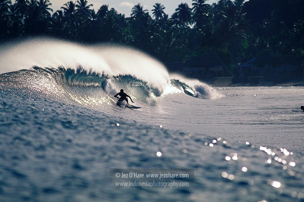 Surfing in Lagundri Bay, Nias, North Sumatra, Indonesia.