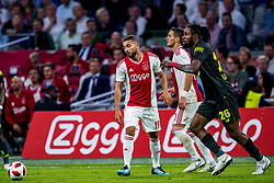 14-08-2018 NED: Champions League AFC Ajax - Standard de Liege, Amsterdam<br /> Third Qualifying Round,  3-0 victory Ajax during the UEFA Champions League match between Ajax v Standard Luik at the Johan Cruijff Arena / Zakaria Labyad #19 of Ajax, Christian Luyindama #26 of Standard Liege