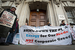 © licensed to London News Pictures. London, UK 16/02/2013. People blocking the entrance of Department of Energy and Climate Change in Whitehall, London as they protesting against the high energy and fuel prices dictated by the six big energy companies in the UK. Photo credit: Tolga Akmen/LNP