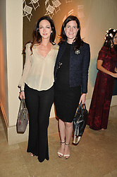 Left to right, CELIA WEINSTOCK and LADY LAURA CASH at a private view of the Beulah Winter Autumn Winter collection entitled 'Chrysalis' held at The South Kensington Club, London SW7 on 24th September 2015.