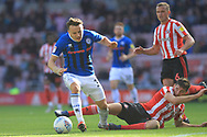 Ollie Rathbone is challenged during the EFL Sky Bet League 1 match between Sunderland and Rochdale at the Stadium Of Light, Sunderland, England on 22 September 2018.