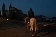 Swiss/Italian pilgrim Claudio Modola rides his horse Cortez at the end of his 44 days' horseback journey from the Spain-France border across four different Spanish regions on a 870 Kilometres trek on the Way of St. James, or El Camino de Santiago, a network of ancient pilgrim routes stretching across Europe and converging at the tomb of St. James (Santiago in Spanish) in Santiago de Campostela in northwest Spain, on November 27, 2020 as he enters Santiago de Campostela, Galicia, Spain. The Camino de Santiago is being affected by Covid-19 with strict restrictions regarding services and mobility along the routes. Starting October 30, 2020, Spanish authorities closed among others, the  perimeter of Santiago de Compostela. Only pilgrims that have been journeying before October 30 can stop at the cathedral of Santiago de Campostela, but they are not allowed to stay overnight and have to transit through.