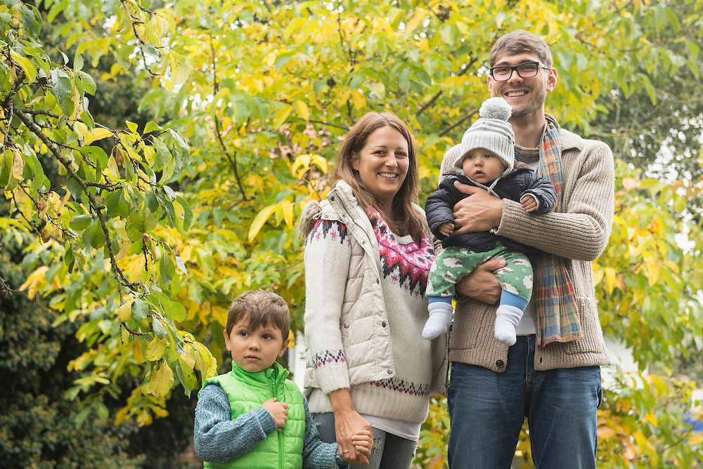 Portrait of a nuclear family standing in an organic farm and smiling, Bavaria, Germany