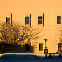 1001512     Brian Leddy<br /> Patrick Brown, left, and Artencio Lynch wait for a ride after class Monday evening in front of Gurley Hall at the University of New Mexico-Gallup.