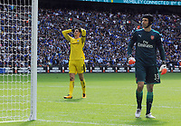 Football - 2017 Community Shield - Chelsea vs. Arsenal<br /> <br /> Thibaut Courtois of Chelsea holds his hands to his head after blasting the ball over the bar in the penalty shoot out past fellow goalkeeper Petr Cech of Arsenal at Wembley.<br /> <br /> COLORSPORT/ANDREW COWIE