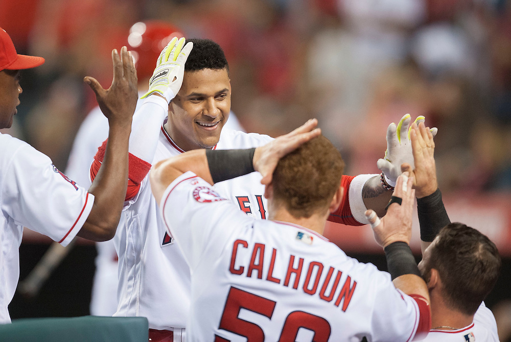 The Angels' Jefry Marte celebrates with teammates after his three-run home run in the sixth inning against the Oakland Athletics at Angel Stadium on Tuesday.<br /> <br /> ///ADDITIONAL INFO:   <br /> <br /> angels.0803.kjs  ---  Photo by KEVIN SULLIVAN / Orange County Register  -- 8/2/16<br /> <br /> The Los Angeles Angels take on the Oakland Athletics at Angel Stadium.