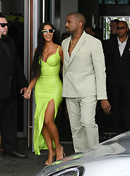 Kim Kardashian wears a neon yellow latex dress as she and husband Kanye West arrive to the wedding of 2 Chainz at the Versace Mansion in Miami Beach, Florida. 18 Aug 2018 Pictured: Kim Kardashian West; Kanye West Kim Kardashian. Photo credit: MEGA TheMegaAgency.com +1 888 505 6342