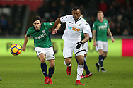 Jordan Ayew  of Swansea city challenges Claudio Yacob of West Bromwich Albion. Premier league match, Swansea city v West Bromwich Albion at the Liberty Stadium in Swansea, South Wales on Saturday 9th December 2017.<br /> pic by  Andrew Orchard, Andrew Orchard sports photography.