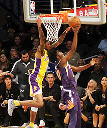 November 17, 2017 - Los Angeles, California, U.S - Suns Josh Jackson goes up and under Lakers defender  Brandon Ingram for the layup and score during the contest  as the host Los Angeles Lakers fall to the visiting Phoenix  Suns 122-113 on Friday, November 17, 2017 at the Staples  Center in Los Angeles, California. (Credit Image: © Prensa Internacional via ZUMA Wire)