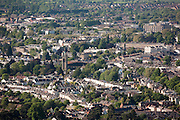 Terraced houses, tower of St Philip and St James Church, Leckhampton and facade of Suffolk square regency architecture (at right) in aerial view of tree lined streets of Cheltenham Spa Town seen from Leckhampton Hill