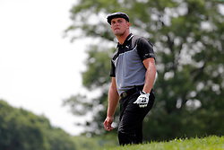 June 22, 2018 - Cromwell, CT, U.S. - CROMWELL, CT - JUNE 22: Bryson DeChambeau of the United States waits to hit his approach from the rough on 18 during the Second Round of the Travelers Championship on June 22, 2018, at TPC River Highlands in Cromwell, Connecticut. (Photo by Fred Kfoury III/Icon Sportswire) (Credit Image: © Fred Kfoury Iii/Icon SMI via ZUMA Press)
