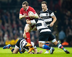 Hadleigh Parkes of Wales is tackled by Wiehahn Herbst of Barbarians <br /> <br /> Photographer Simon King/Replay Images<br /> <br /> Friendly - Wales v Barbarians - Saturday 30th November 2019 - Principality Stadium - Cardiff<br /> <br /> World Copyright © Replay Images . All rights reserved. info@replayimages.co.uk - http://replayimages.co.uk