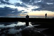 ALERIA, CORSICA - 18/09/2005 - TRAVEL, Tourist waking up at Aleria beach..© Christophe VANDER EECKEN