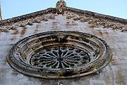 Rose window and Acroterium atop the facade of Saint Mark's (Sveti Marko) Cathedral, Korcula old town, island of Korcula, Croatia